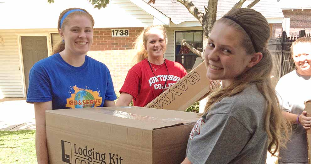 students carrying boxes during Big Red Day of Service