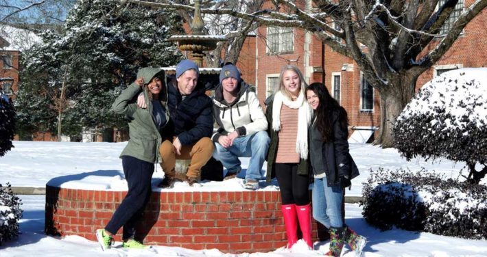 students at the fountain in the snow