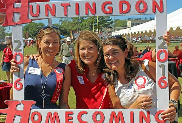 Friends with Homecoming sign