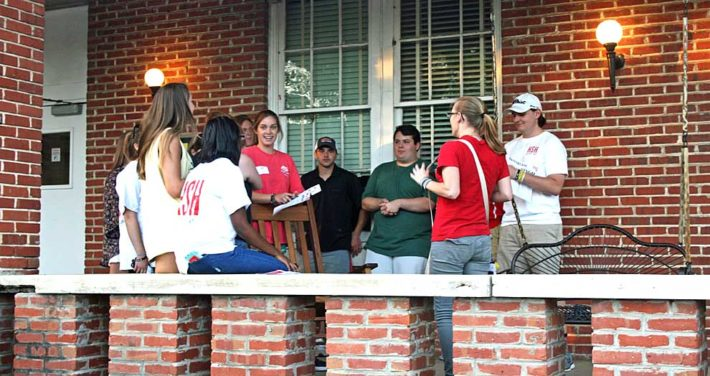 students on porch