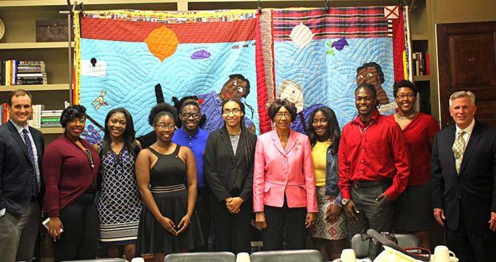 Folk artist Yvonne Wells with Black Student Union students