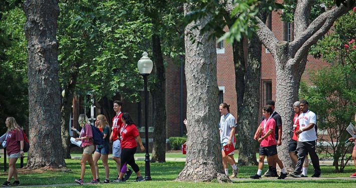 orientation students walking on the Green