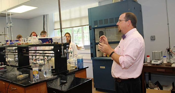 Dr. John Berch teaching in chemistry lab